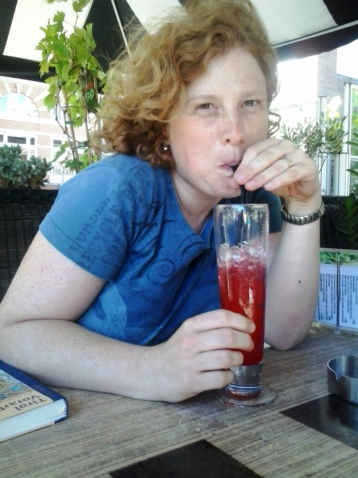 Picture of Cosette drinking a strawberry daiquiri. To visualise About us