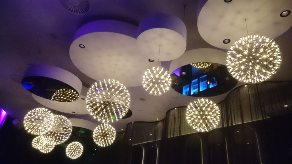 Hanging lightbulbs consisting of dozens of small lights at the skybar on top of the hotel.
