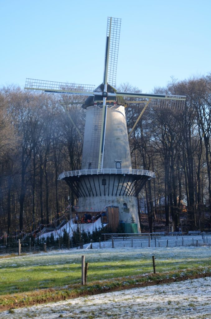 To show a picture of something we did in January. A windmill in a frosty landscape. Pasture in front, trees behind it. A tubing lane in front of the mill.
