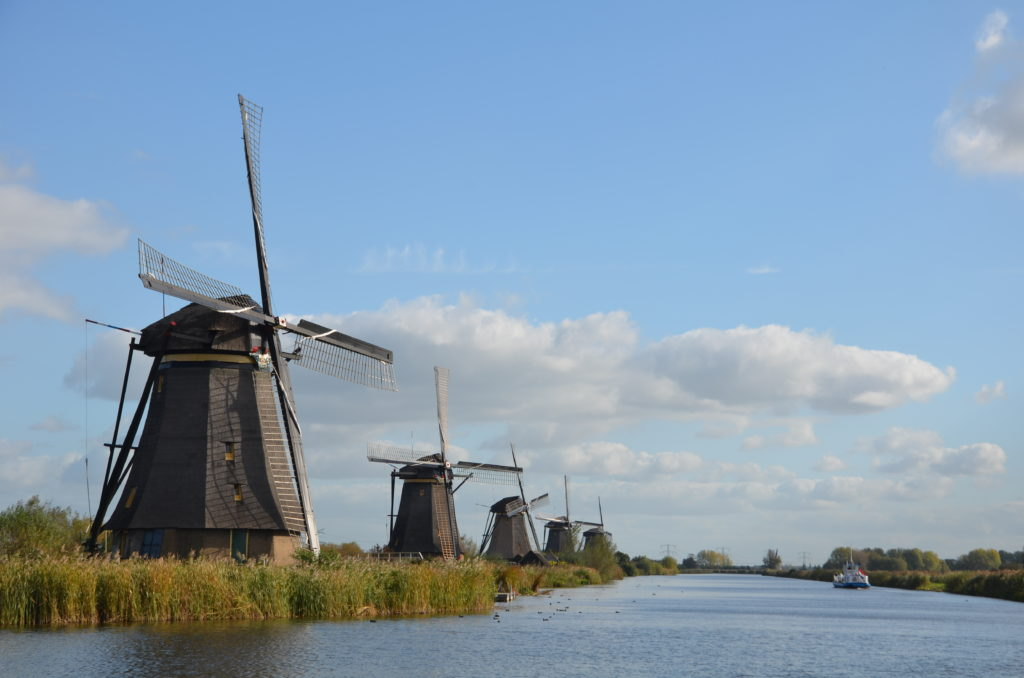 To show something popular from The Netherlands near the campsites. The windmills from Kinderdijk in a row. The river flowing in front of them. Campsites in The Netherlands.