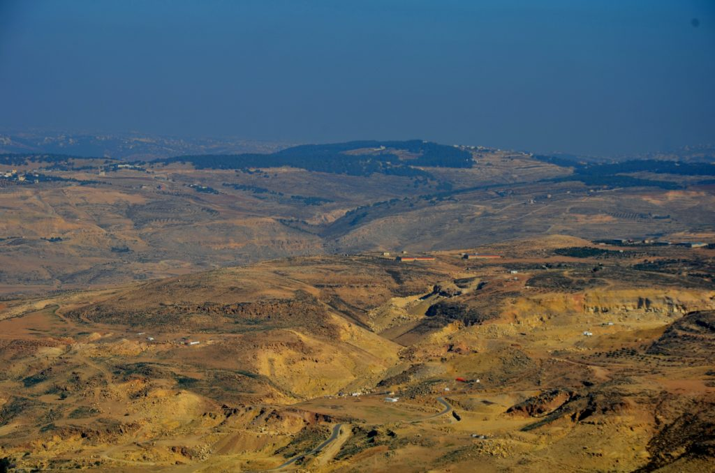 To show how far you could look from Mount Nebo. The rurrounding mountains and fields looking from on top of mount Nebo.