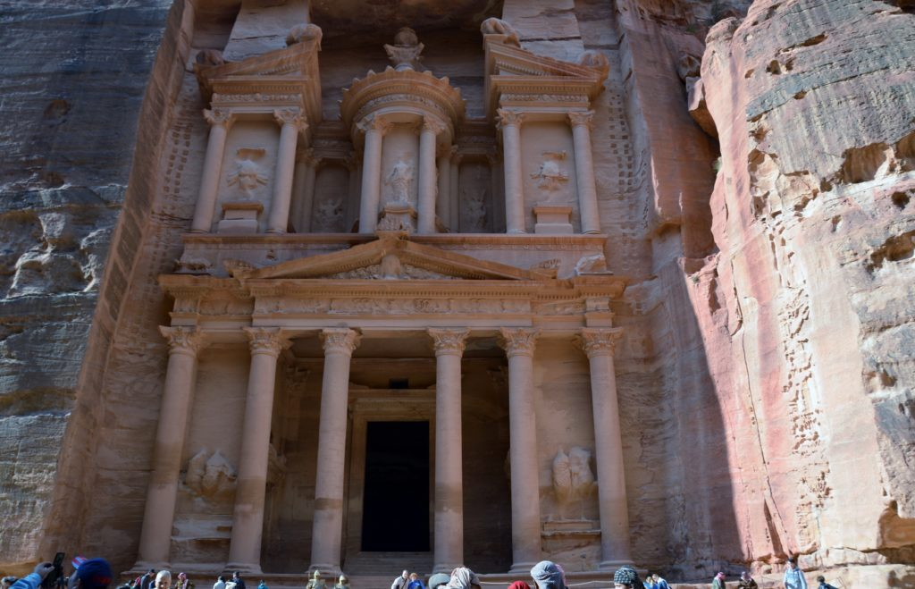 To show the most famous picture of Petra, the Treasury. Yor see the Treasury, a gave tomb carved out in the Red rose rocks. Below in the picture heads of the crowds in front.