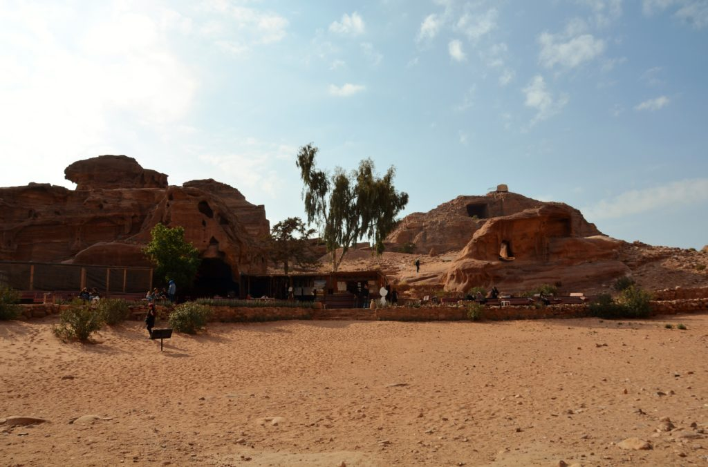To show a picture of one of the restaurants in Petra itself. A mslla restaurant between the rocks a few trees here and there. Rose red colored rocks everywhere.
