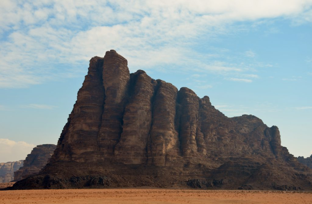 To show a picture of the 7 pilars of Lawrence of Arabia. One of the sites we visited on our tour through Jordan. You see a large rock which is formed into 7 pilars. Surrounded by desert.