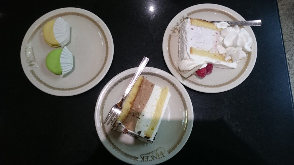 To show what we had at Vincek. 3 plates, two with a slice of cake (different cakes), one woth macarons.