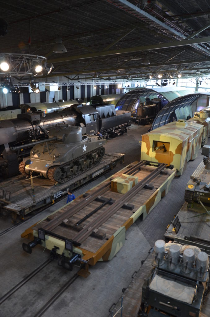 Several army trains and locks displayed inside the museum