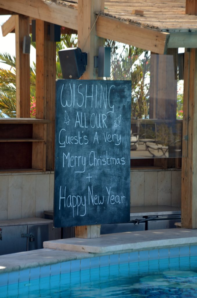 A text to show that they try to let people know that they know it's Christmas. A chalk board with the text written on it: Wishing all our guests a very merry Christmas + Happy New Year.
