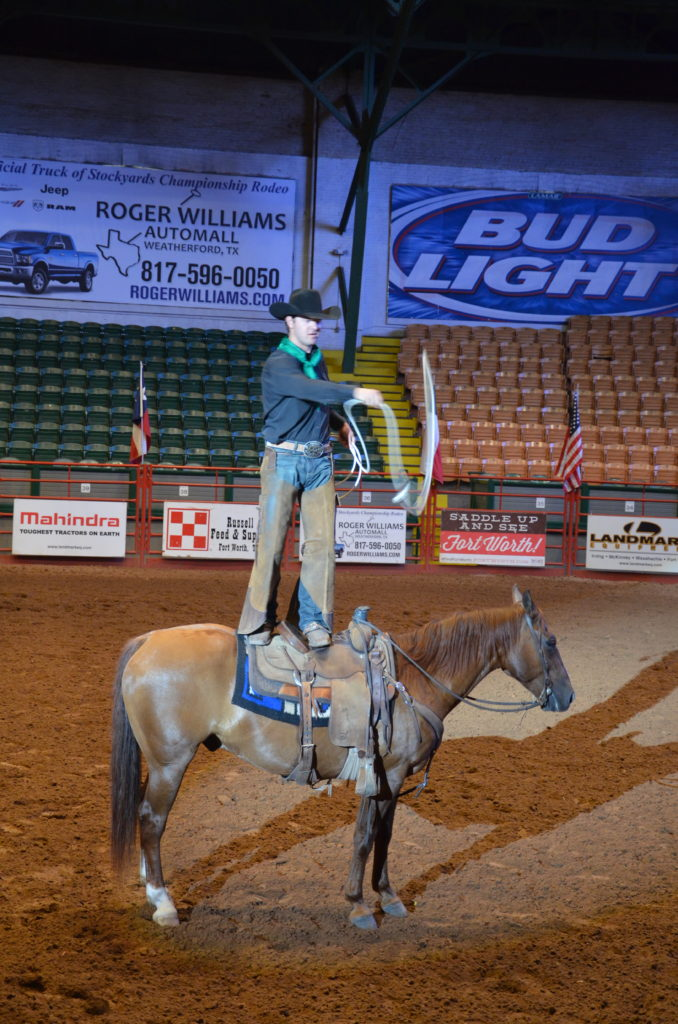 To show a part of the rodeo show, in this instance a cowboy standing on a horse.