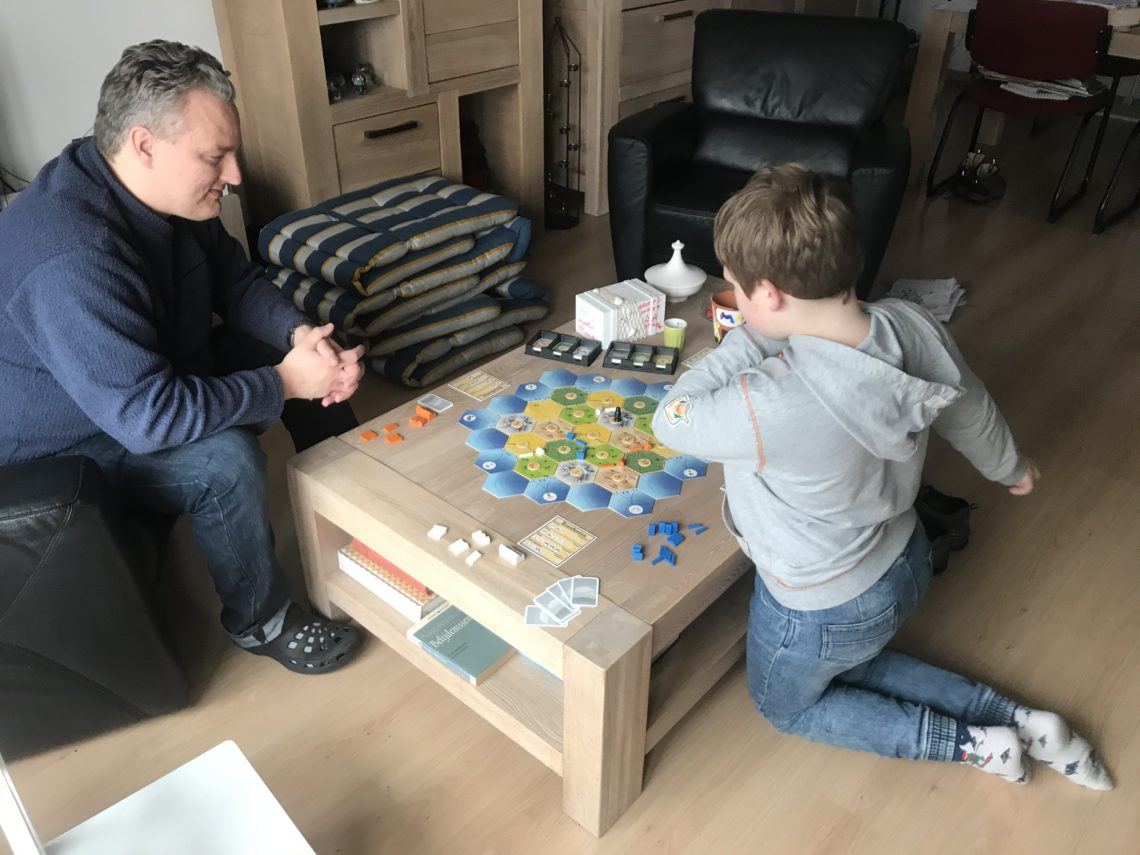 To show us playing a board game