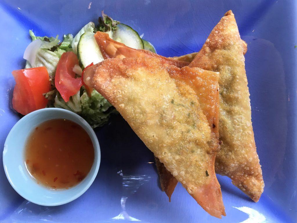 To show a dish: pangsit goreng from gember & sereh.