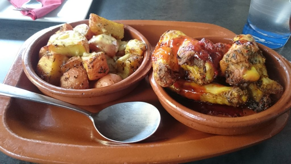 To show the tapas: Chicken wings and patatas bravas. Eat in Utrecht