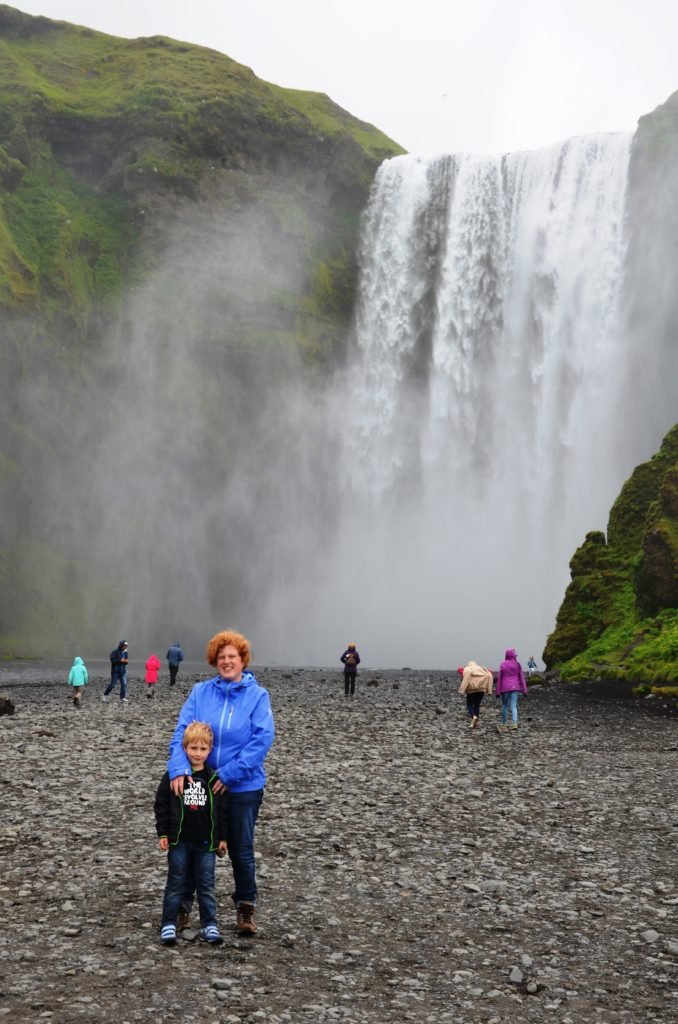 Yuri and me in front of Skogafoss. Finding peace