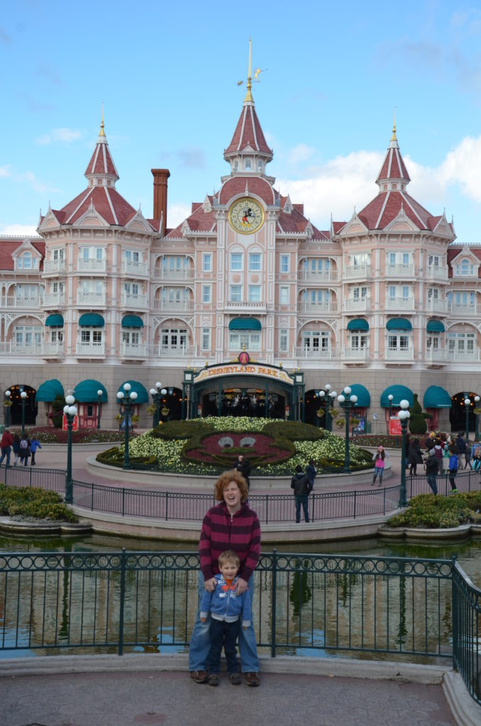 Yuri and Cosette in front of Disneyland Park