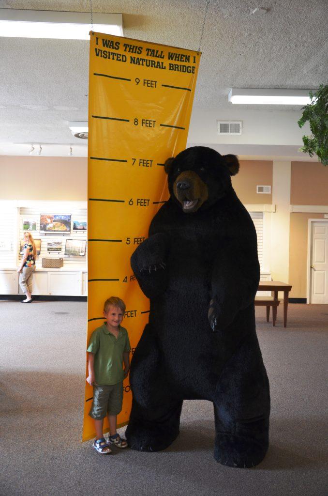 Yuri standing next to a black bear
