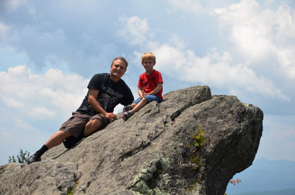 The Blowing Rock. Yuri and Paul sitting on a rock