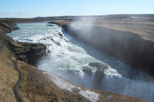 An empty Gullfoss in 2006, an overview of Gullfoss, seeing the 2 traps. Brown (not yet gree) grass with a bit of snow in the front
