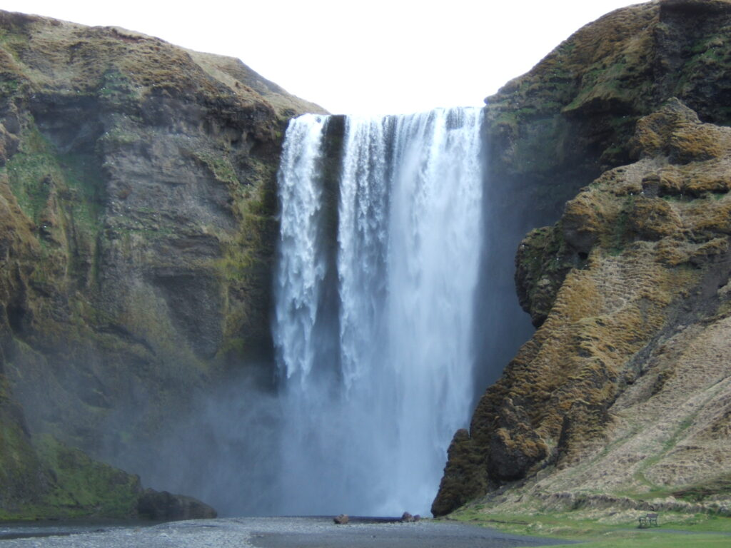 Skogafoss, a waterfall dropping down over a rock into the rover below.