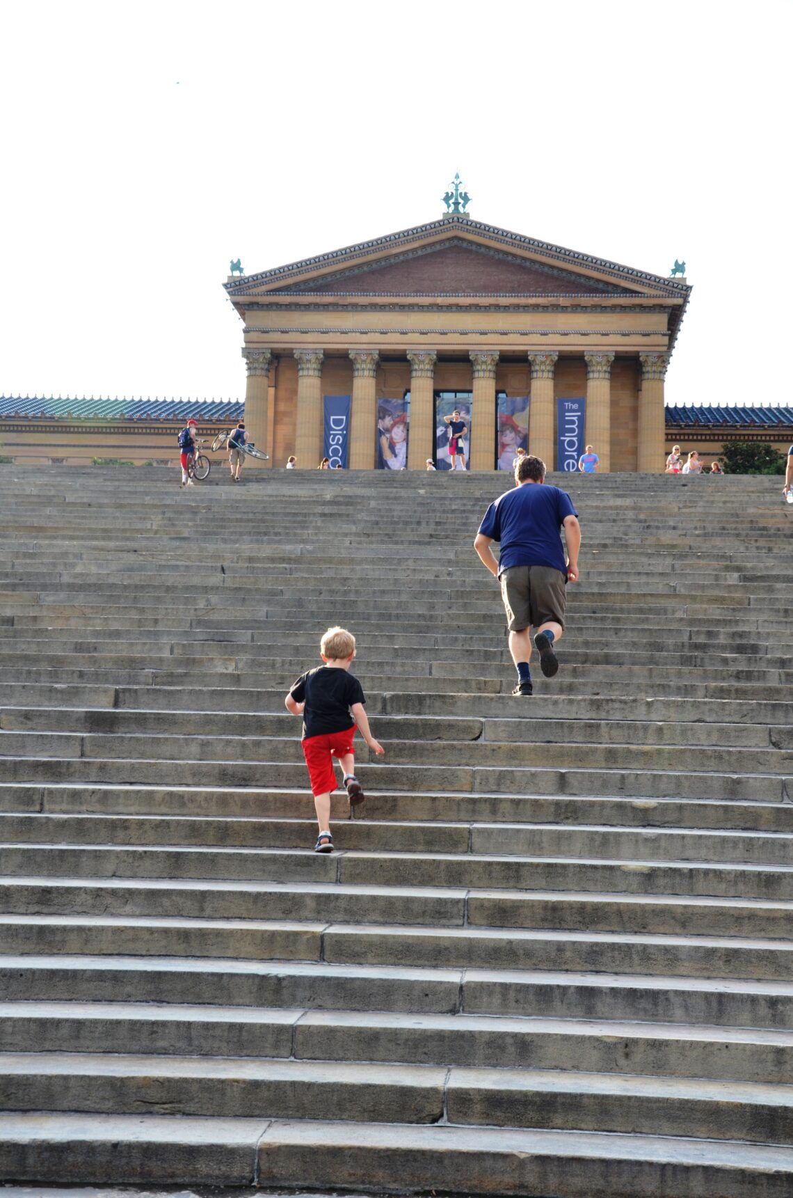 Who's first? Paul and Yuri seen from the back. Running upstairs on the Rocky steps. Paul is faster than Yuri.