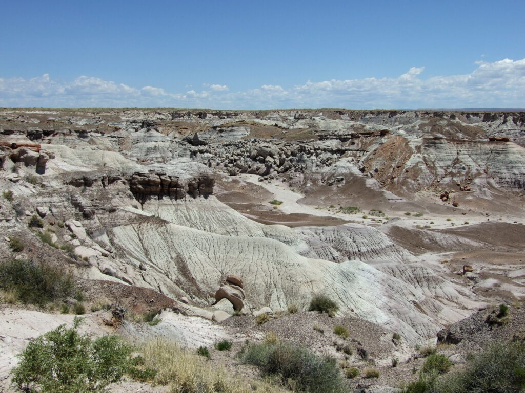 View on the badlands, looking into a valley with grey and brown badlands