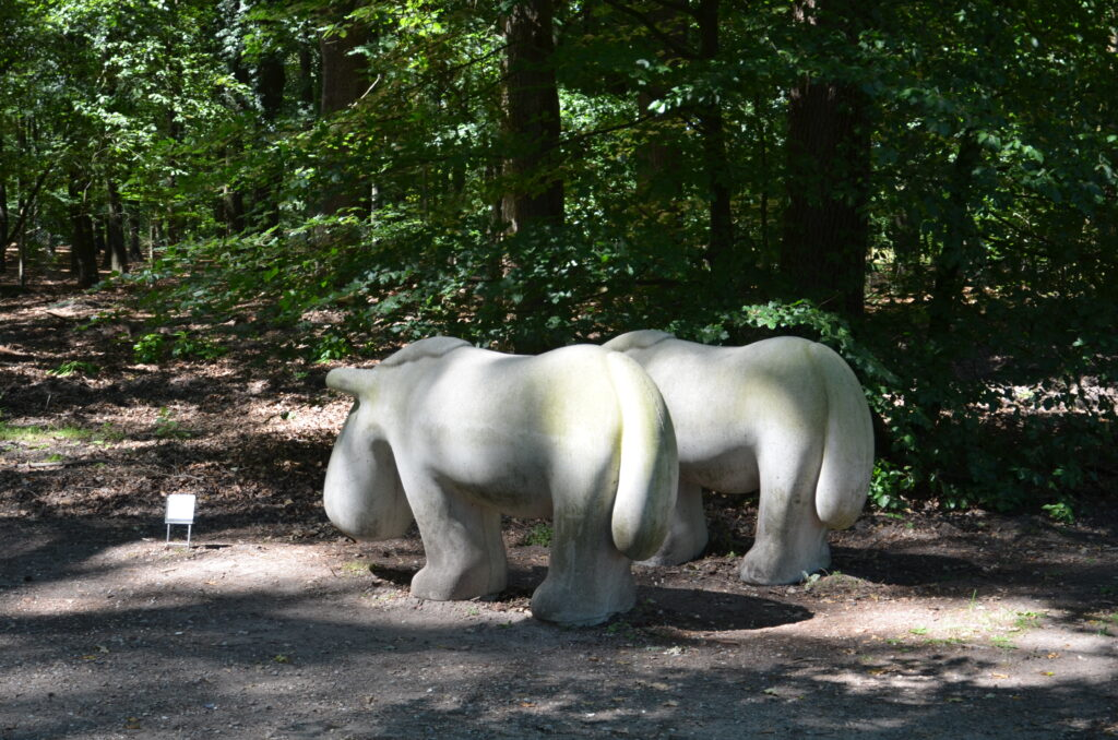 2 pony statues, in the middle of the forest