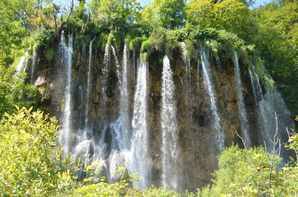 Plitvice Falls, small streams dropping down between the greens