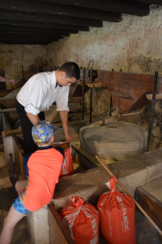 A water mill, Yuri looking what a man is doing. He's placing cement in the mill