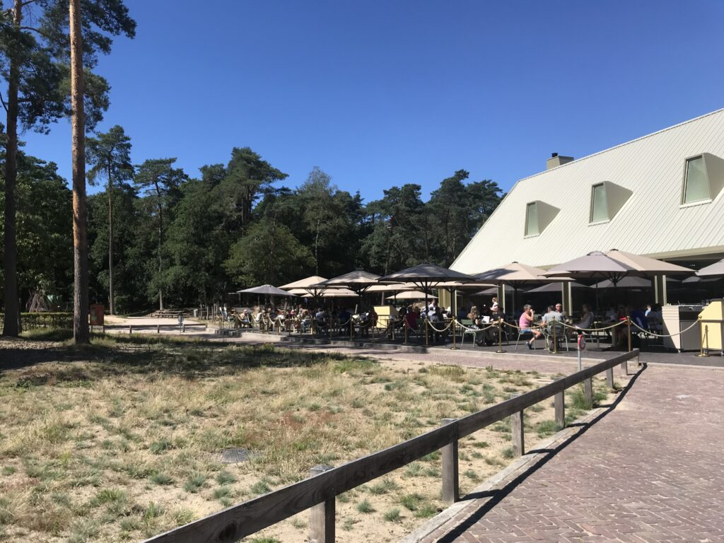 Parkrestaurant with terrace, Forest at the back