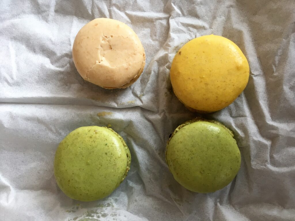 Macarons! A yellow, creme and 2 green ones.