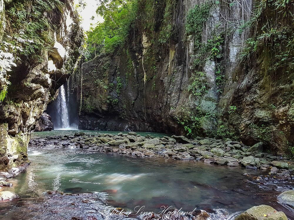 Bagongbong Waterfall, in the back on the left a fall drops down in a gorge into a river