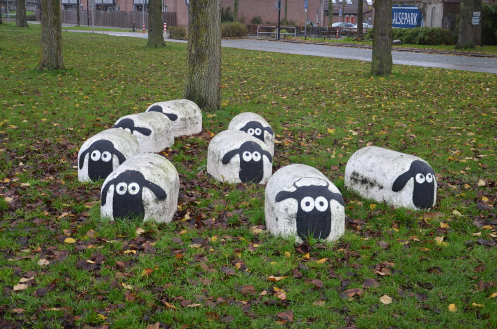 Concrete sheep in the middle of a park
