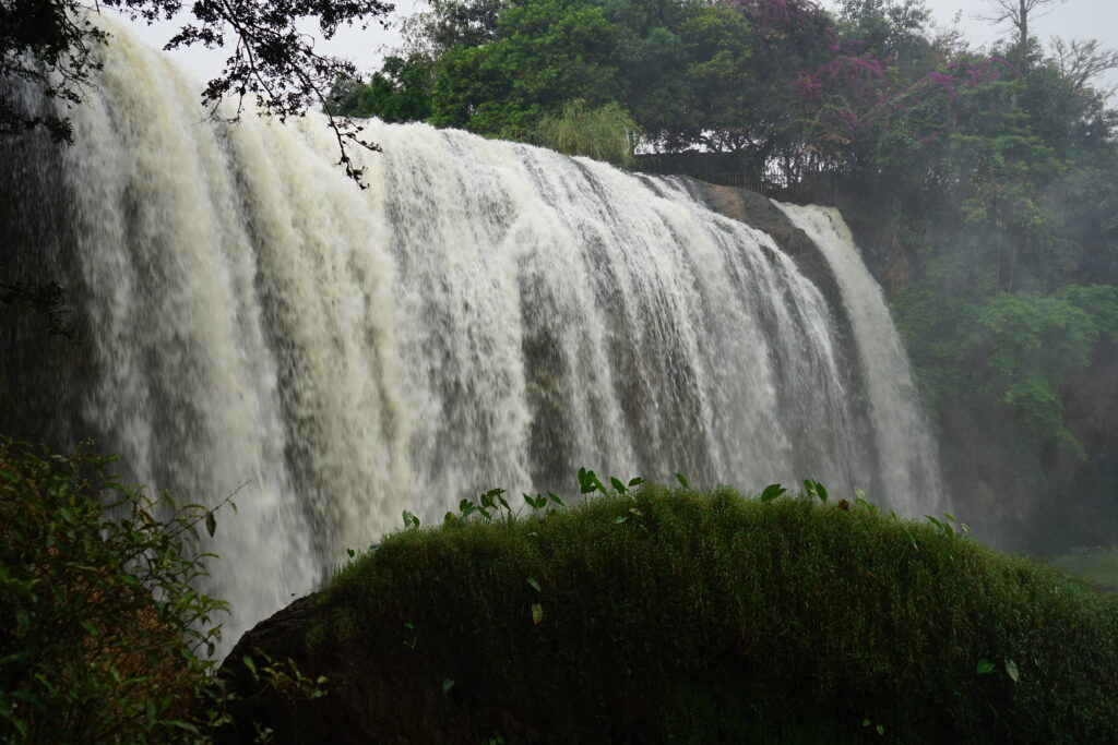 Elephant Waterfall, a broad waterfall that's wide, taking up most of the picture