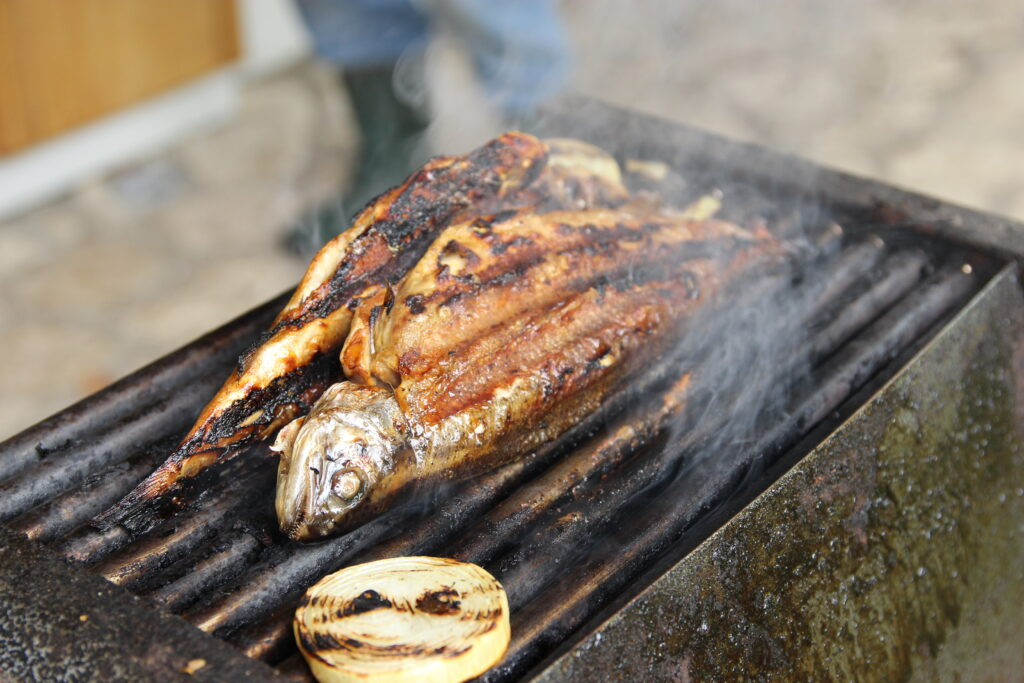 Fish, on a barbecue, almost done. A whole fish