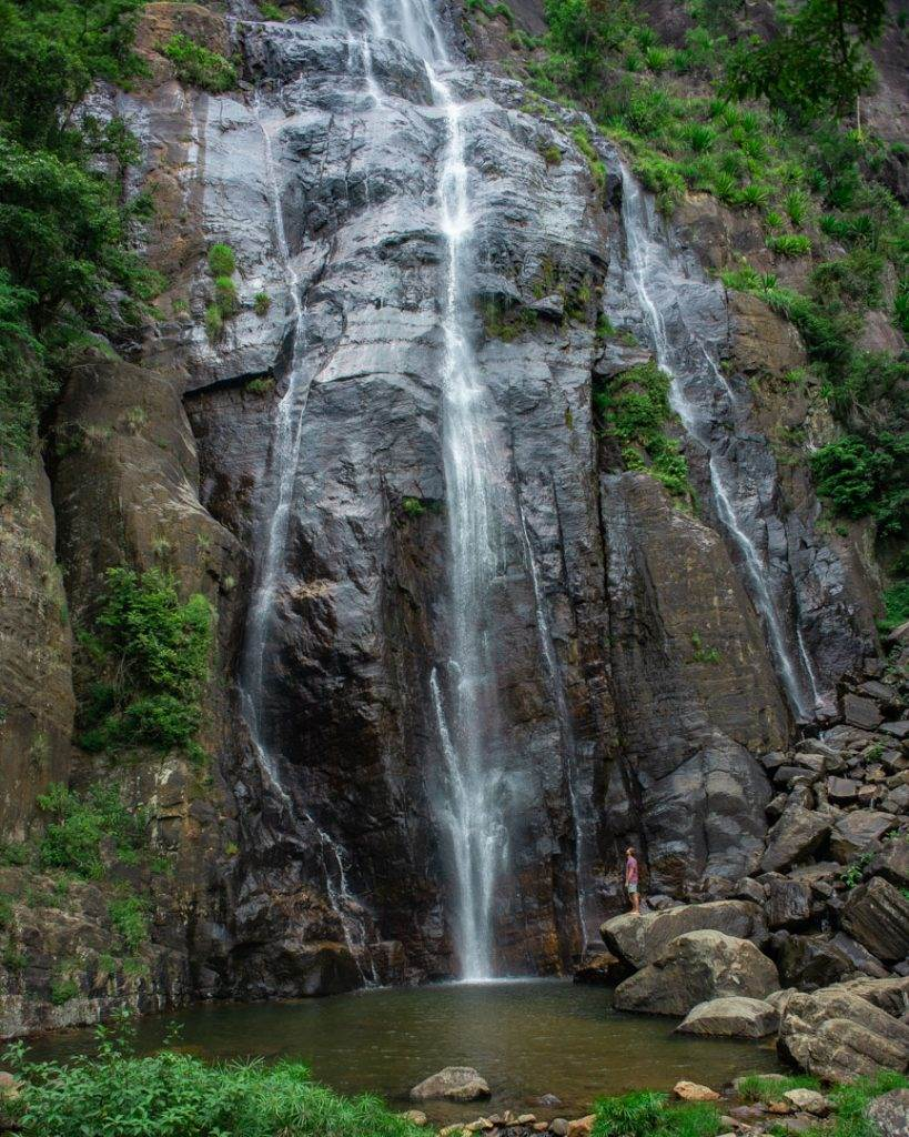 Bambarakanda Waterfall a single drop down a rock, close to it, with streams on the side