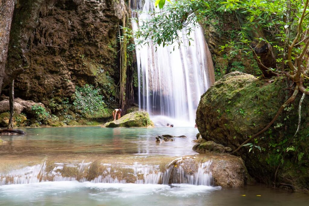 Erawan Falls, on the right a waterfall drops down in a lake/pool, that turns into a river