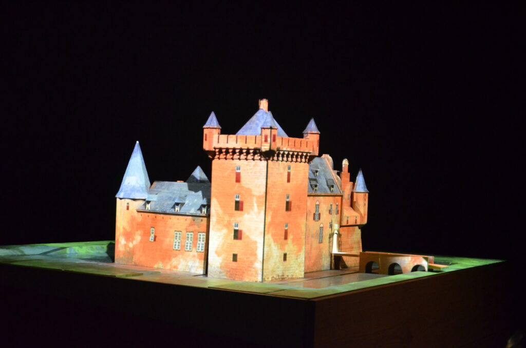 A model of Castle Hernen in the Middle Ages, lighted up, the rest is dark