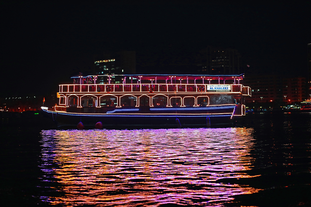 Dhow Cruise, a boat let up with colorful lights in the dark