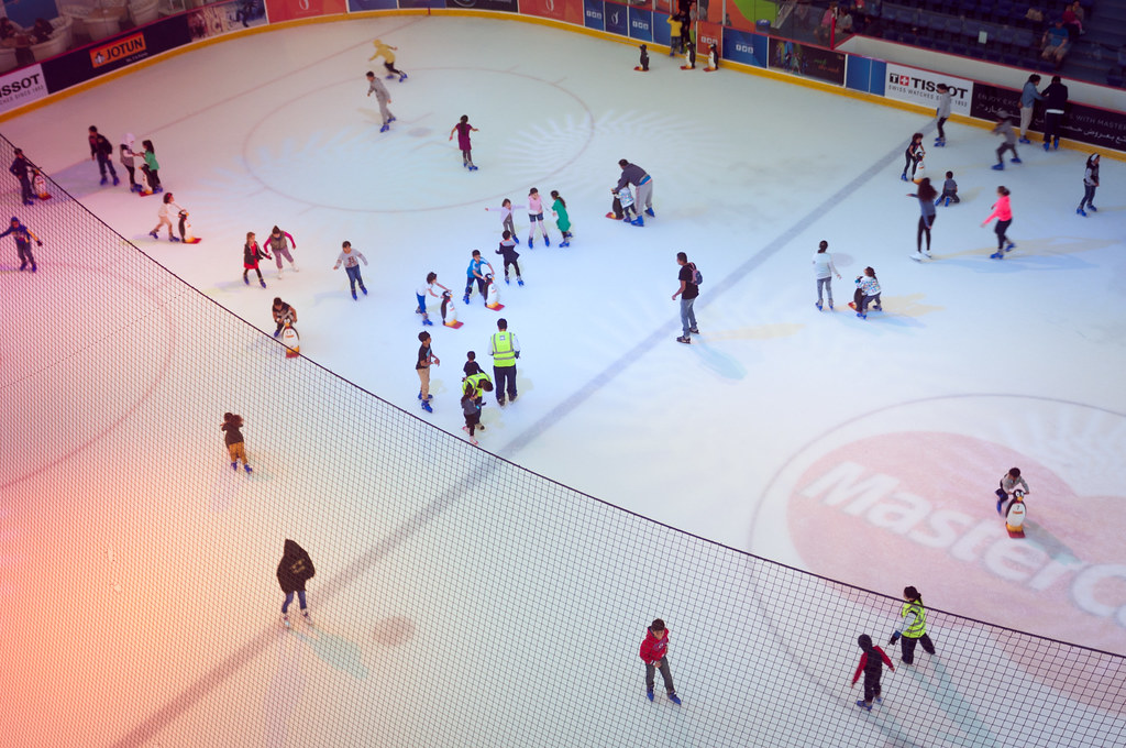 Ice Rink, seen from above, with lots of people skating on it