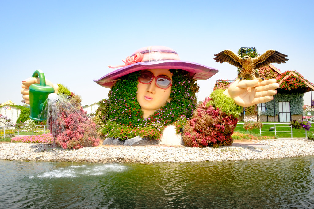 Miracle Garden, a woman head made from flowers, on the water all sorts of colors.