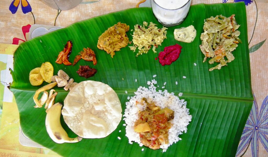 Sadya meal, presented on a banana leaf, all sorts of dishes. One of the traditional foods of Kerala.