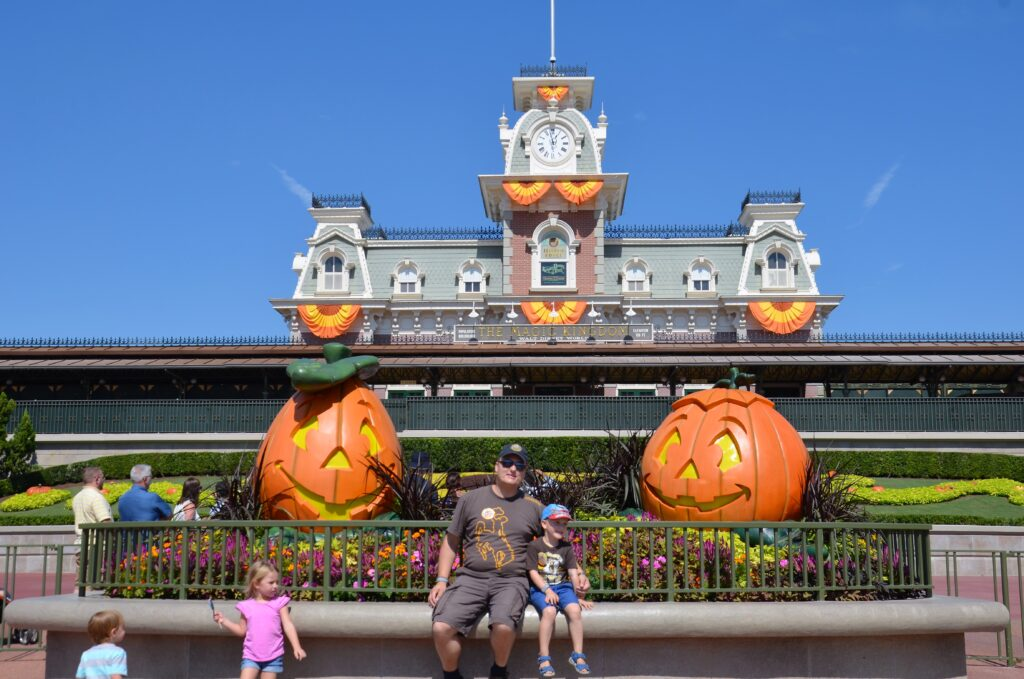 Entrance to Magic Kingdom, with halloween decorations up. Paul and Yuri in the middle of the picture