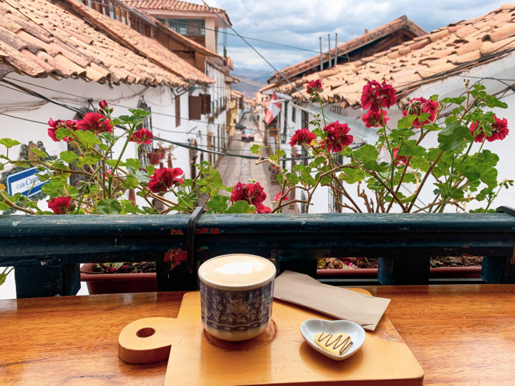 Balcony View of San Blas, L'atelier cafe by Packing up the Pieces, acup of coffee on a table with a view on the surrounding neighbourhood