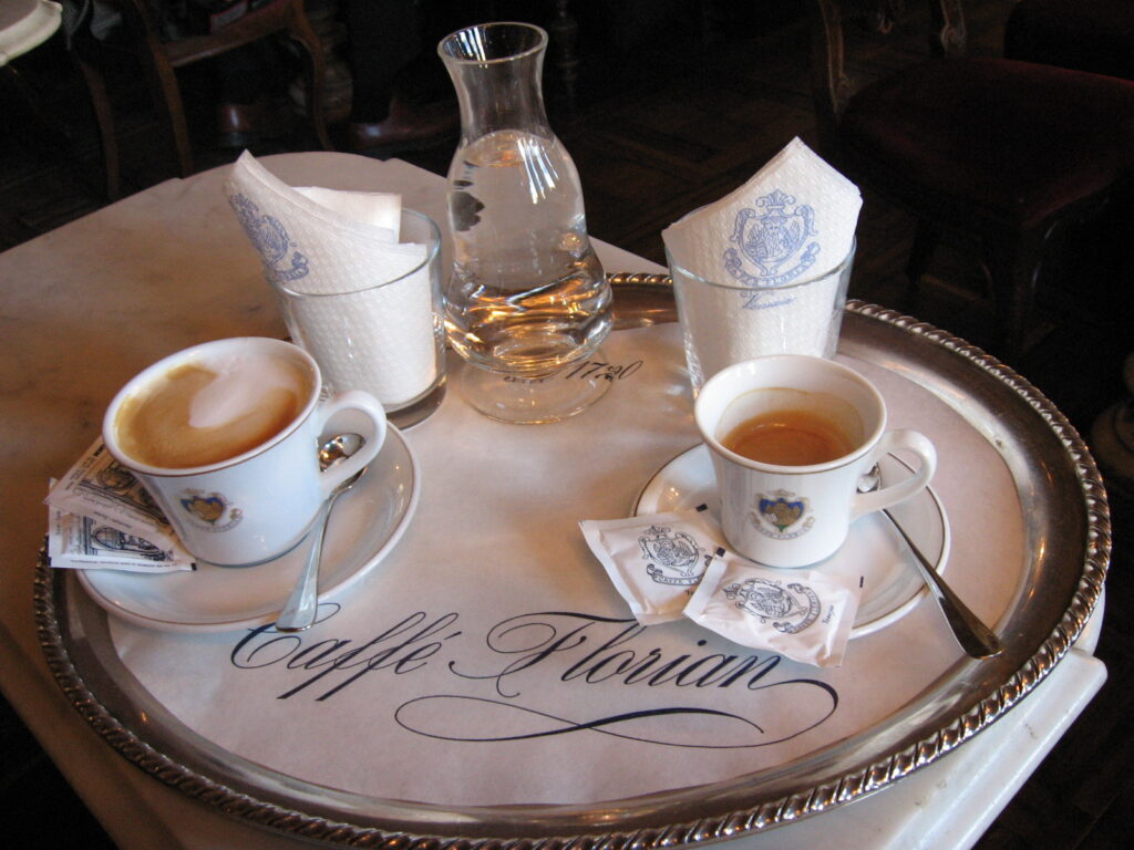Caffe Florian by Travel for a While, coffee and tea on a tray. With water and empty glasses