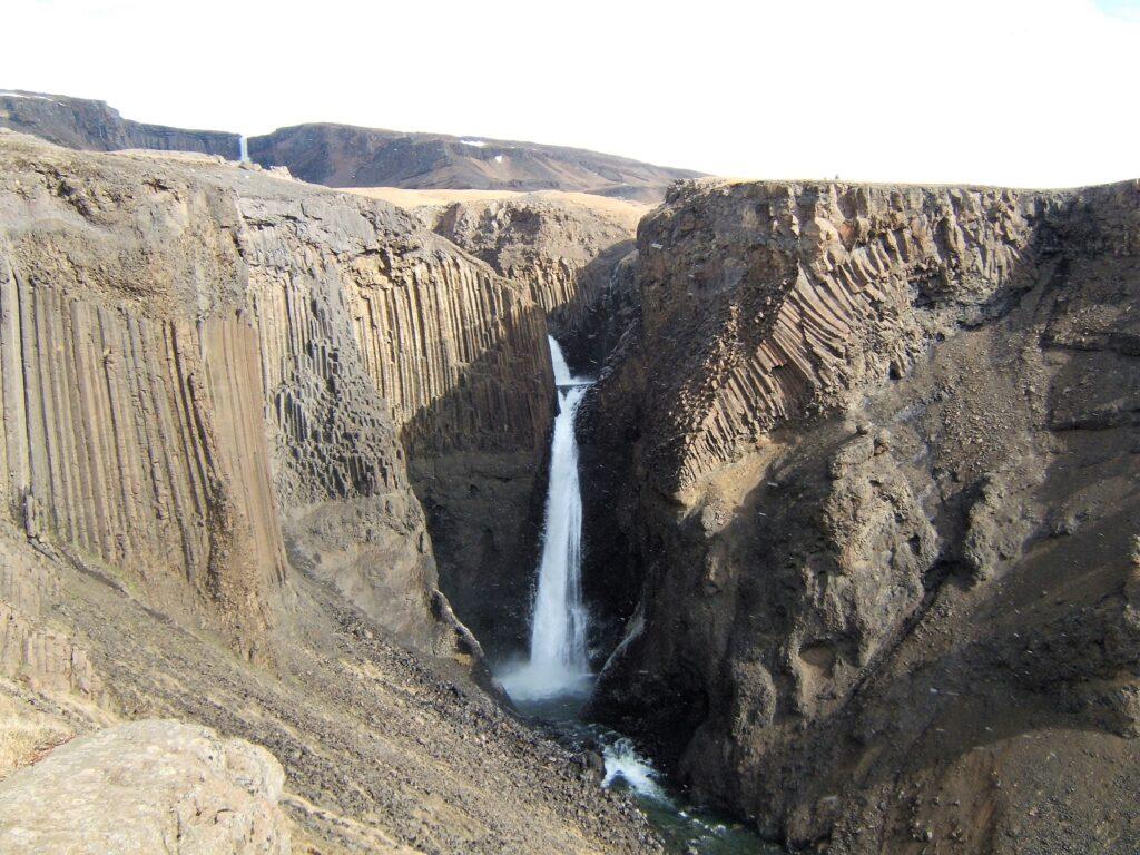 Litlanesfoss, dropping down between hexatoganal basalt columns