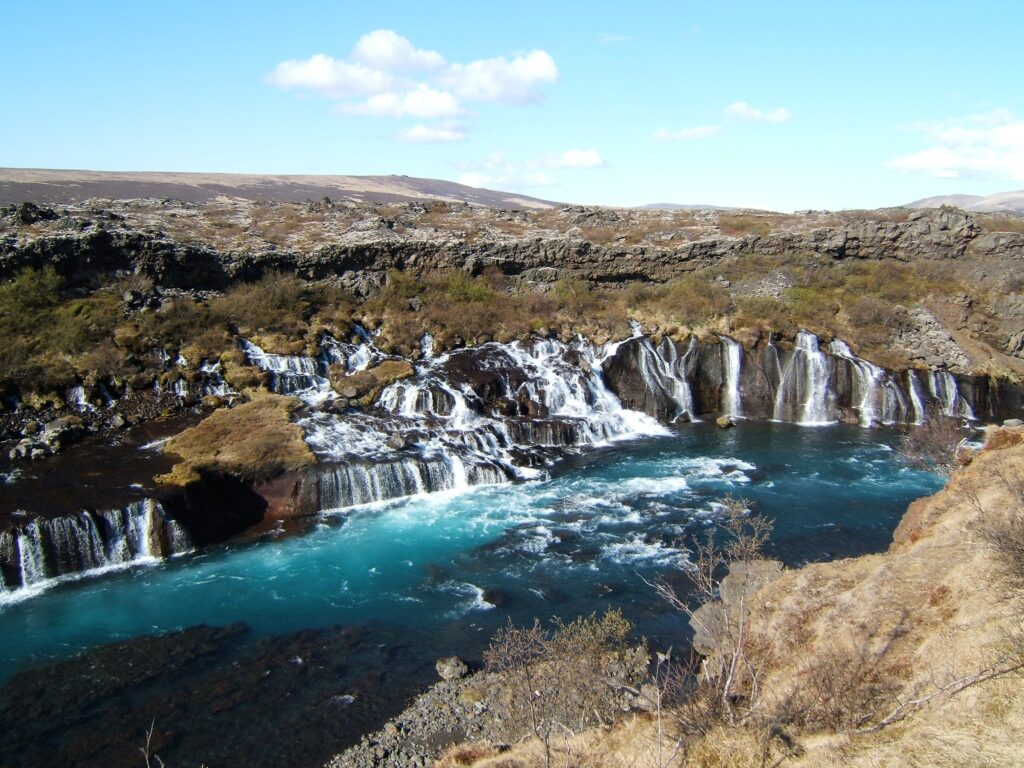 Hraunfossar, seen from the left, the several waterfalls flowing in the river