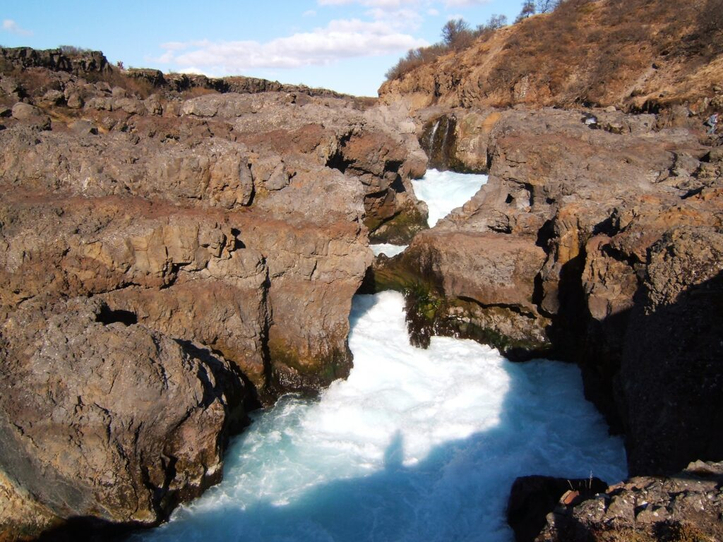 Barnafoss, a wild roaring waterfall surrounded by brown rocks