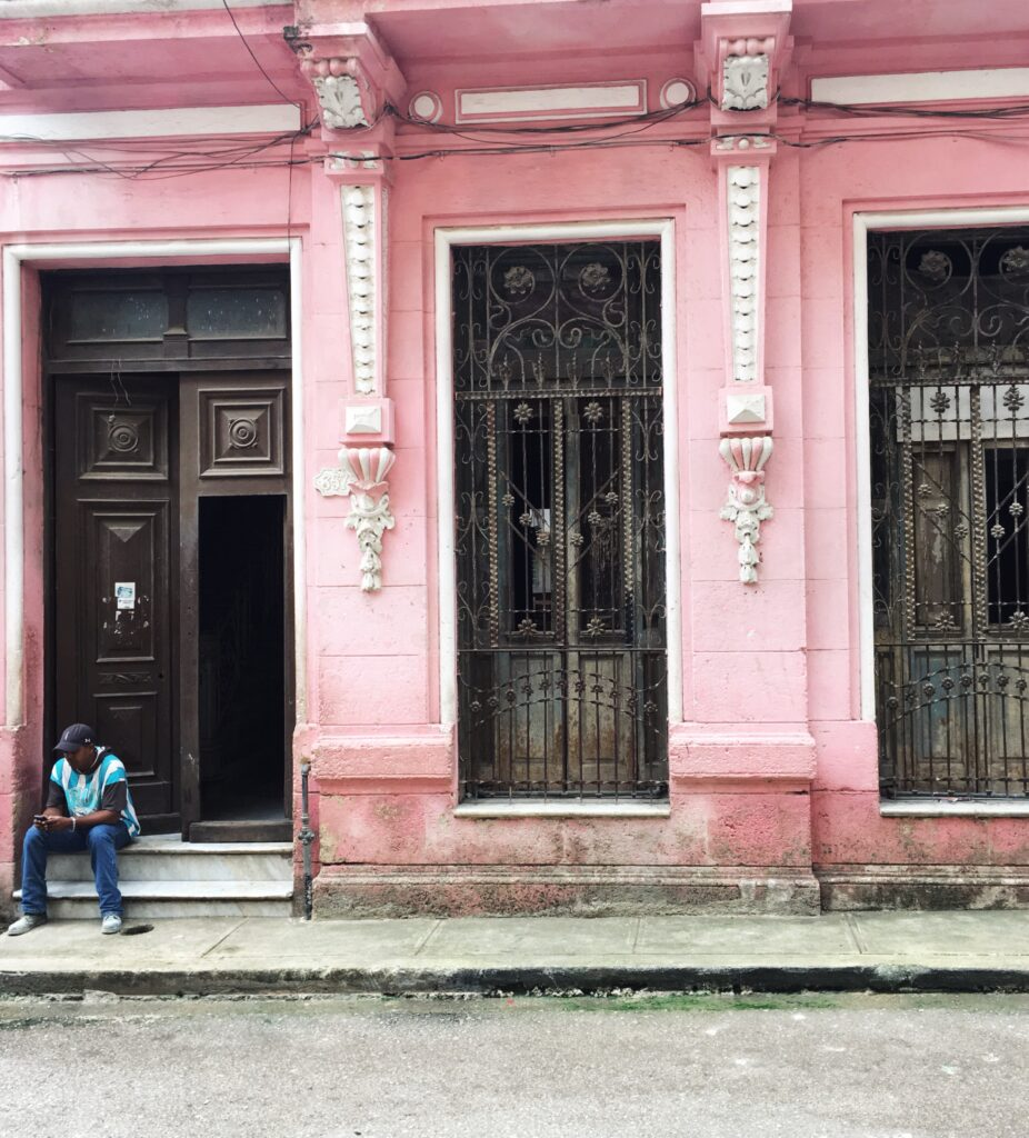 El Cafe by Home to Havana, the cafe from the outside, an old pink building