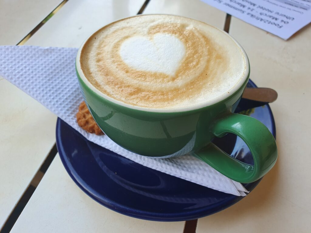 Union Cafe by The World in my Pocket, a cup of coffee with a heart drawn on it in Latte art