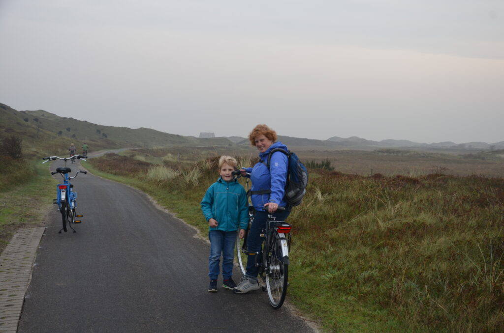 Yuri and Cosette in the dunes on bikes