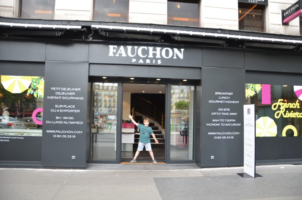 Fauchon during our Paris macaron walking tour with Yuri standing in the doorway