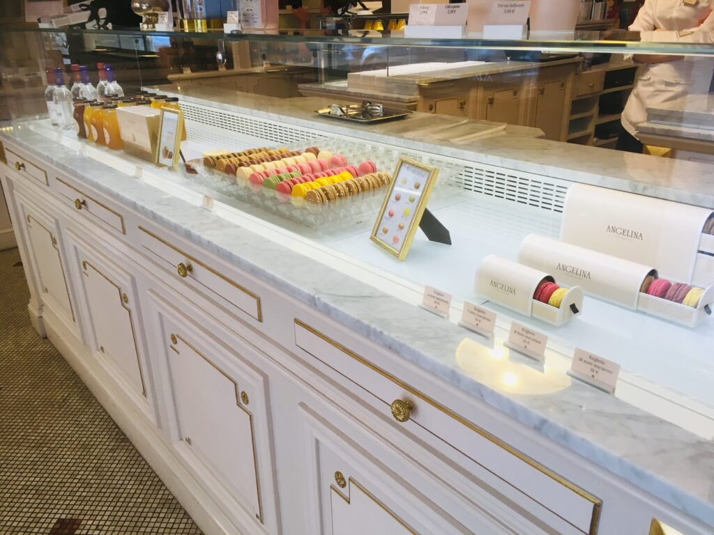 Macarons at the counter at Angelina Paris